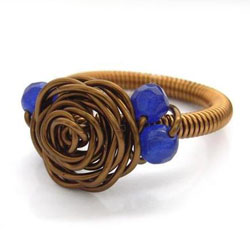 Blue Forest Jewellery - hand twisted bronze wire rose ring with faceted blue quartzite beads and coiled shank